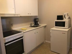 Køkken eller tekøkken på Motel Apartments