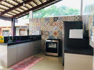 Una cocina o zona de cocina en CASA CANTO DO JAÓ