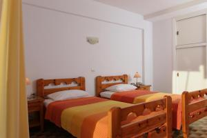 A bed or beds in a room at Apollon Apartments