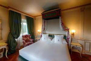 Ein Bett oder Betten in einem Zimmer der Unterkunft Villa Cora