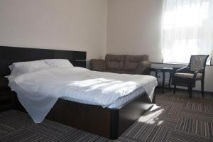 A bed or beds in a room at D-Hotel Tverskaya