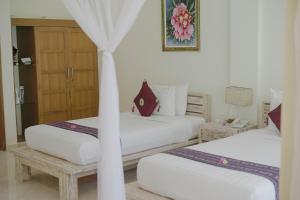 Cama o camas de una habitación en Puri Sari Beach Hotel