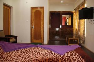 Un ou plusieurs lits dans un hébergement de l'établissement Mentokling Guest House and Garden Restaurant