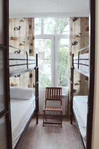 A bunk bed or bunk beds in a room at Tubus