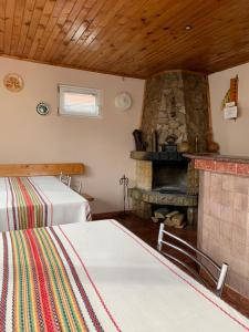 A bed or beds in a room at Sunny House Madjare Guest House