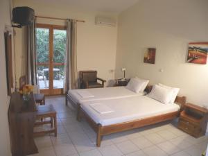 Ein Bett oder Betten in einem Zimmer der Unterkunft Hotel Petit Village