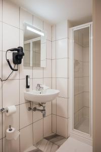 Een badkamer bij ROXI Residence Gent