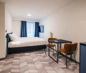 Een bed of bedden in een kamer bij ROXI Residence Gent