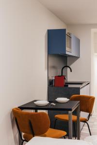 Een keuken of kitchenette bij ROXI Residence Gent