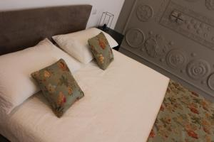 A bed or beds in a room at Il Cavaliere