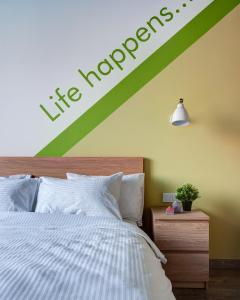 A bed or beds in a room at Roomy Hostel