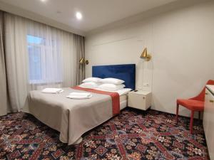 Кровать или кровати в номере Отель История