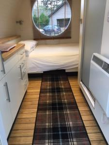 A bed or beds in a room at Eriskay B&B and Aviemore Glamping