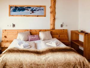 Ein Bett oder Betten in einem Zimmer der Unterkunft Lodge am Krippenstein