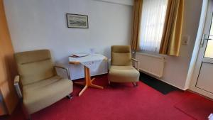 Ein Sitzbereich in der Unterkunft Haus Brigitte