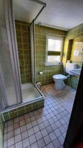 Ein Badezimmer in der Unterkunft Haus Brigitte