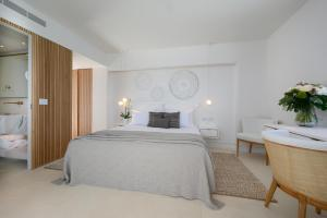 A bed or beds in a room at The Island Concept