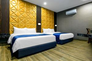 A bed or beds in a room at U3 HOTEL