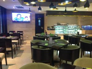 A restaurant or other place to eat at Amari Dhaka