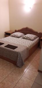 A bed or beds in a room at Romashka Guesthouse