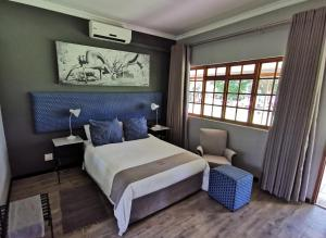 A bed or beds in a room at Grey Goose Game Lodge