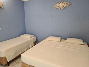 Cama ou camas em um quarto em Pousada Nossa Senhora Aparecida