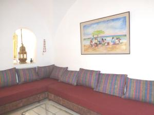 A seating area at Villa with 4 bedrooms in Hammamet with wonderful sea view private pool enclosed garden 850 m from the beach