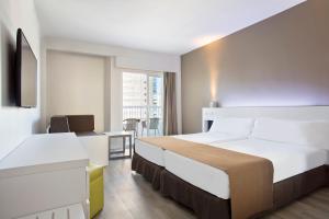 Cama o camas de una habitación en Sol Pelicanos Ocas