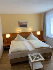 Ein Bett oder Betten in einem Zimmer der Unterkunft Hotel Martina