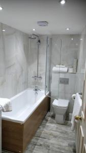 A bathroom at The Spread Eagle Hotel