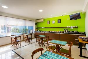 A restaurant or other place to eat at VOA Convenience Hotel