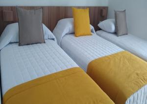 A bed or beds in a room at Villa d'Oro Hotel