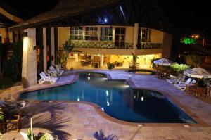 The swimming pool at or near Ilha Flat Hotel