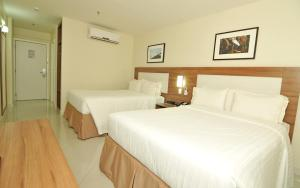 A bed or beds in a room at Holiday Inn Express Belem Ananindeua