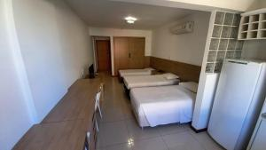 A bed or beds in a room at IKA Apart Hotel