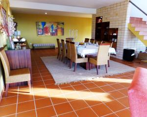 A restaurant or other place to eat at Monica Lisbon Rentals - Vista Villa