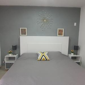 Cama o camas de una habitación en MARLIN TURQUESA RENTAS VACACIONALEs