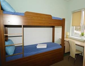 A bunk bed or bunk beds in a room at City Hostel Panorama