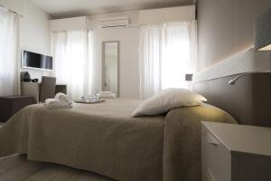 Cama o camas de una habitación en Al Portico Guest House