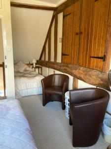 A bed or beds in a room at Bulmer Farm B&B