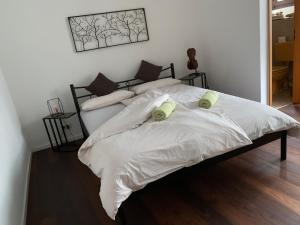 A bed or beds in a room at Ferienwohnung am Franziskaner Tor