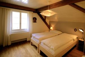 A bed or beds in a room at Gasthaus Schlosshalde