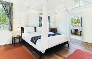 A bed or beds in a room at Temple Tree Resort