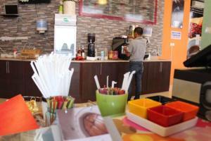 مطعم أو مكان آخر لتناول الطعام في  فندق اولف لاند