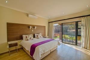 A bed or beds in a room at Seasons Golf, Leisure, Spa