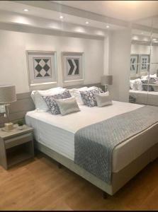 Cama ou camas em um quarto em Hotel Guarany