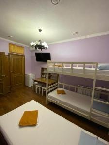 A bunk bed or bunk beds in a room at Hotel Parus City