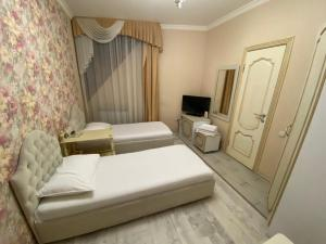 A bed or beds in a room at Hotel Parus City
