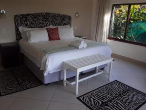 A bed or beds in a room at St Lucia Eco Lodge