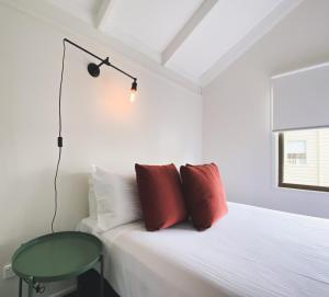 A bed or beds in a room at Nepean by Gateway Lifestyle Holiday Parks